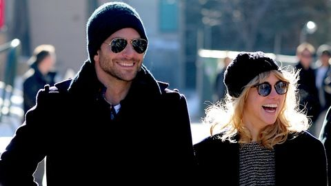 BradleyCooper_SukiWaterhouse_Getty_smiling_warm