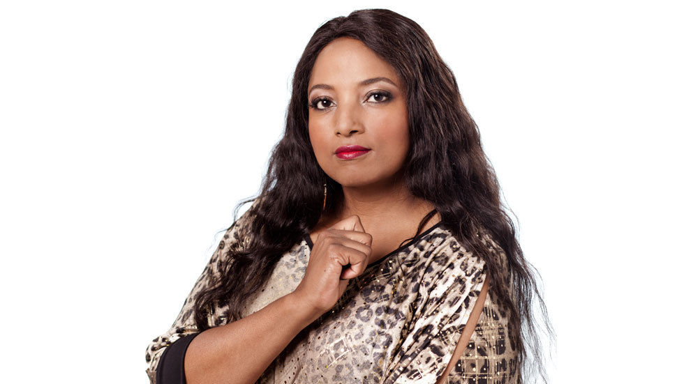 Sexual Health Matters host Criselda Kanada poses in a white background.