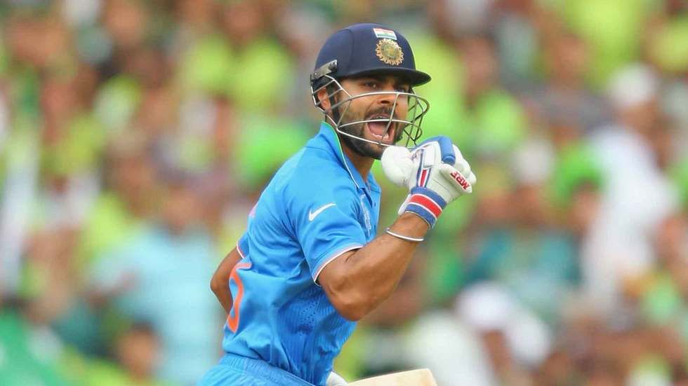 Virat Kholi of India celebrates after completing the winning runs in the World Cup match against Pakistan.