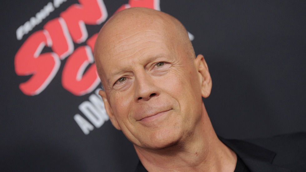 Bruce Willis smiles for the camera.