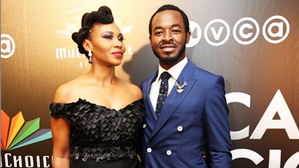 Nse Ikpe Etim and OC Okeje pose at the AMVCA2015 red carpet.