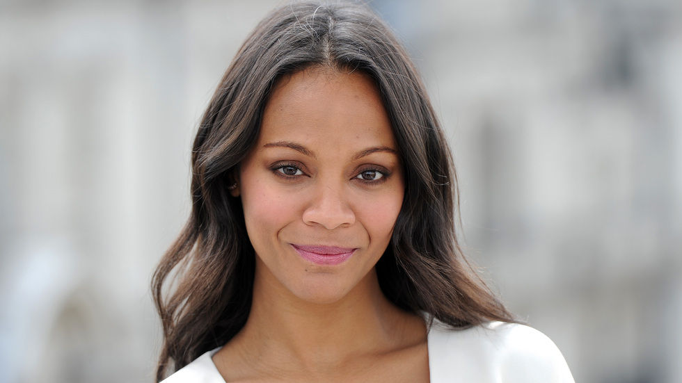 Zoe Saldana portrait with grey background (blurred).