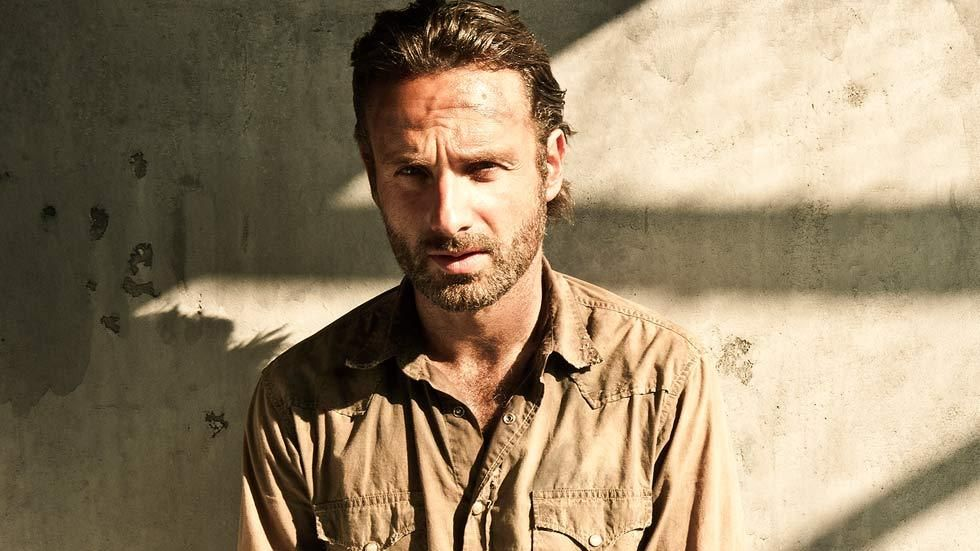 Rick on The Walking Dead, standing against a wall