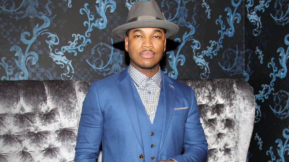 Ne-Yo press shot, suit and hat