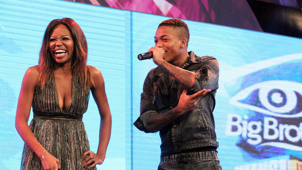 An image of #BBMzansi's S2 housemates Lebo and Ex on stage at the launch
