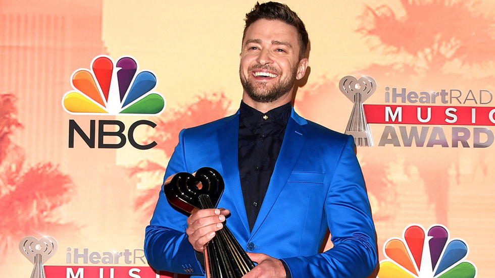 Timberlake holding a trophy, press shot