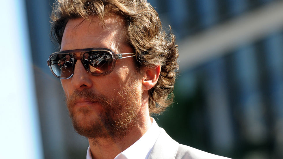 Matthew McConaughey outside in sunnies, close up.