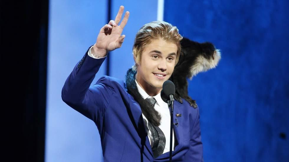 Singer Justin Bieber on the stage of his Comedy Central Roast with his monkey