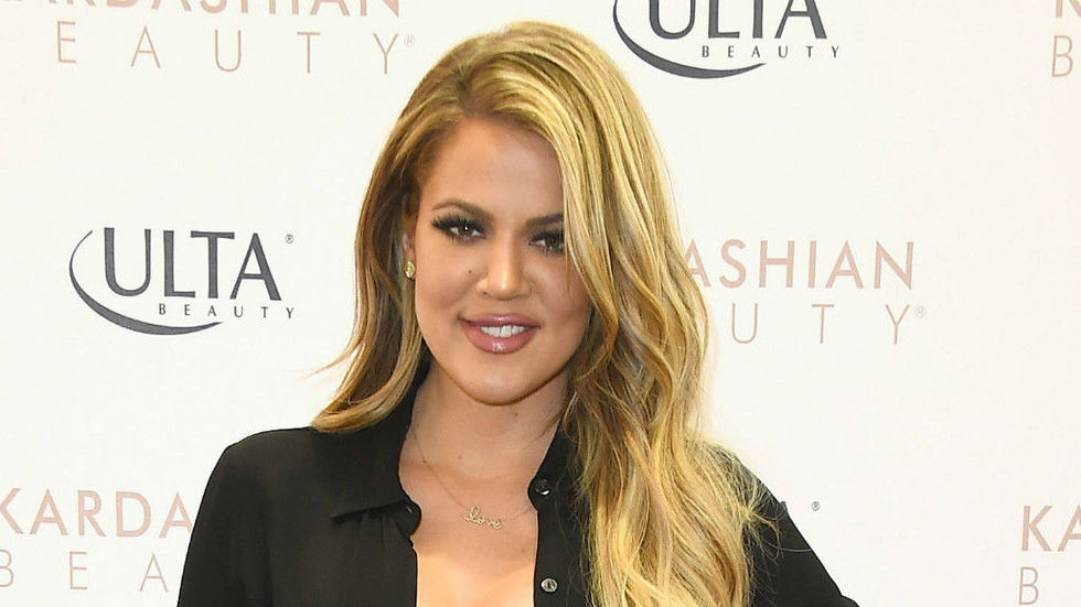 Khloe Kardashian poses on the Ulta red carpet
