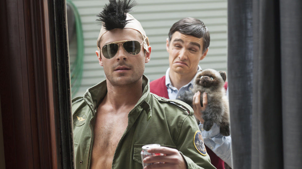 Zac Efron with a wig on, in Bad Neighbours