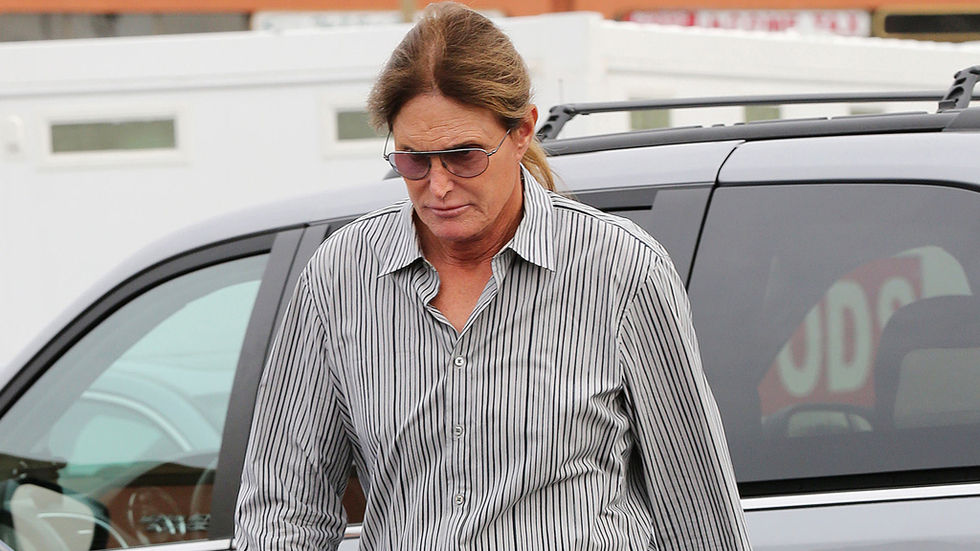 Bruce Jenner walking with sunglasses.