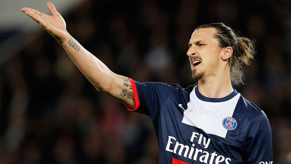 Ibrahimovic of PSG argues with/at someone