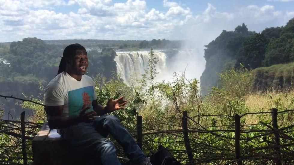 News reporter Ade Adepitan at the Victoria Falls in Zimbabwe for the BBC World News programme, The Travel Show