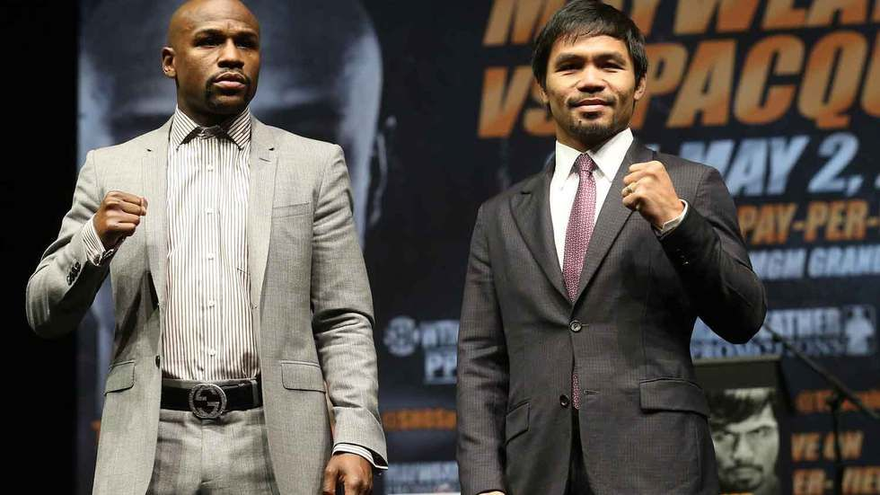 Manny Pacquiao and Floyd Mayweather at a press conference.