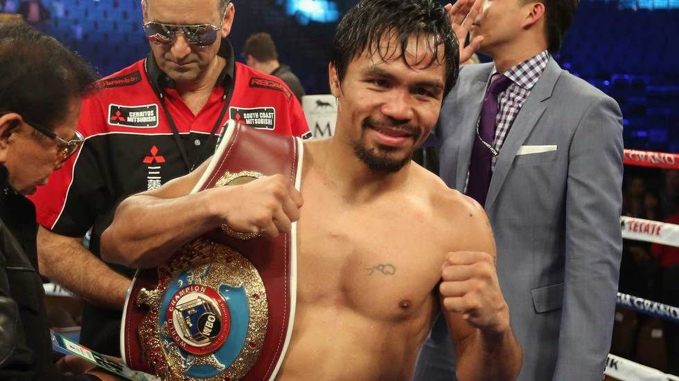 Manny Pacquiao poses for the camera after winning a fight.