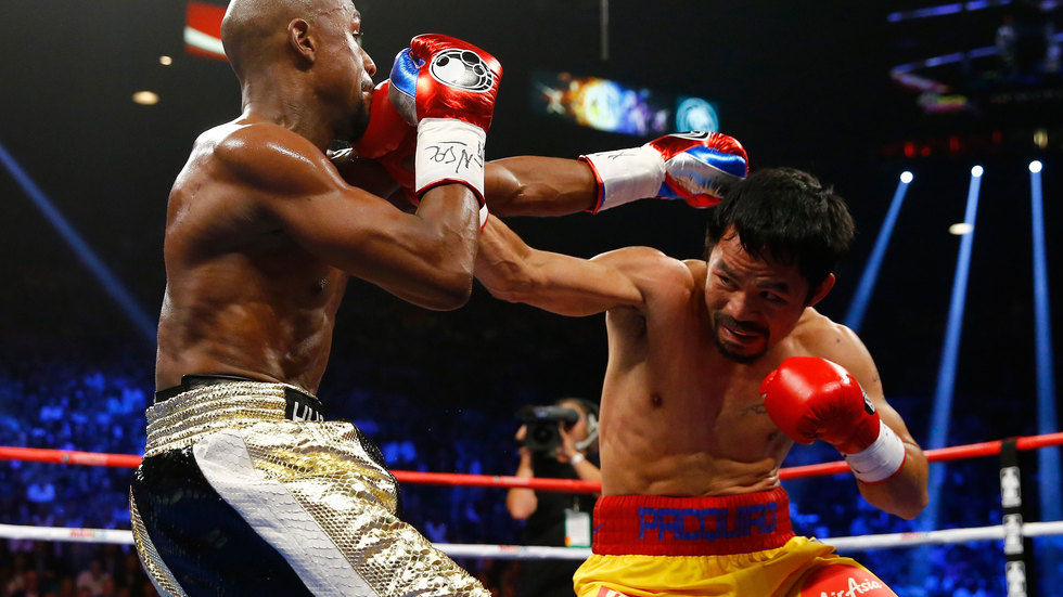 Floyd Mayweather and Manny Pacquiao in action.