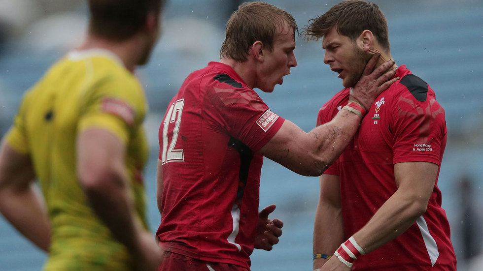 Jevon Groves of Wales fights with his teammate.