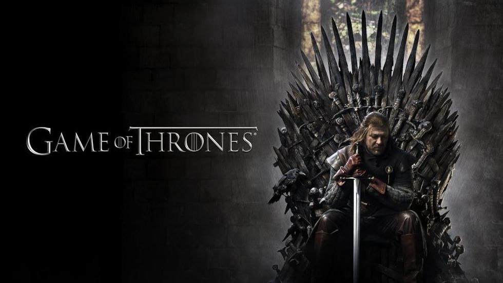 Ned Stark sitting on the Iron Throne in Game of Throne.