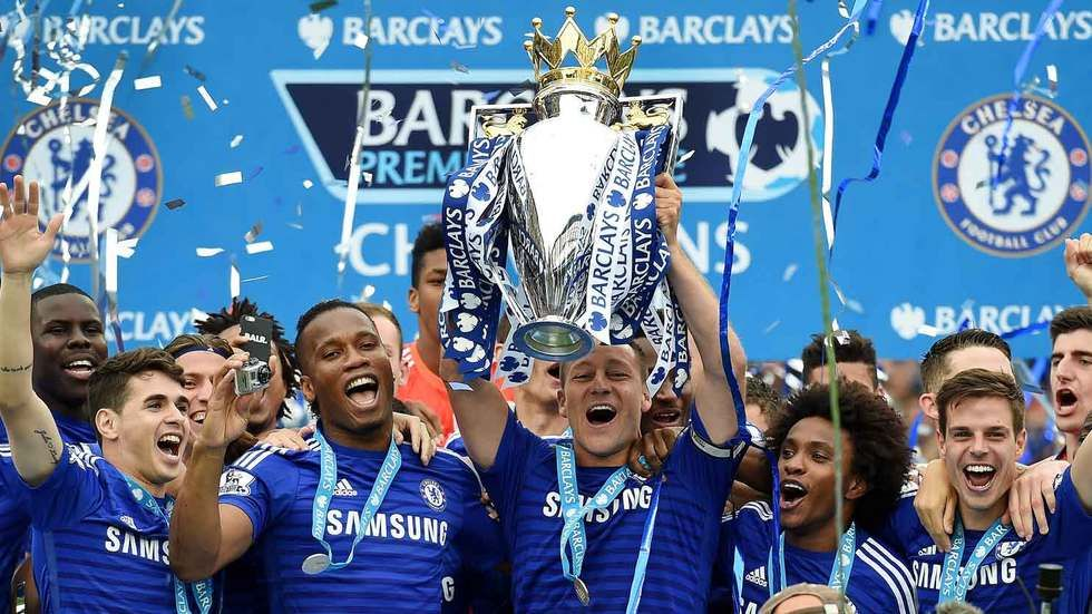John Terry lifts the Barclays Premier League title.