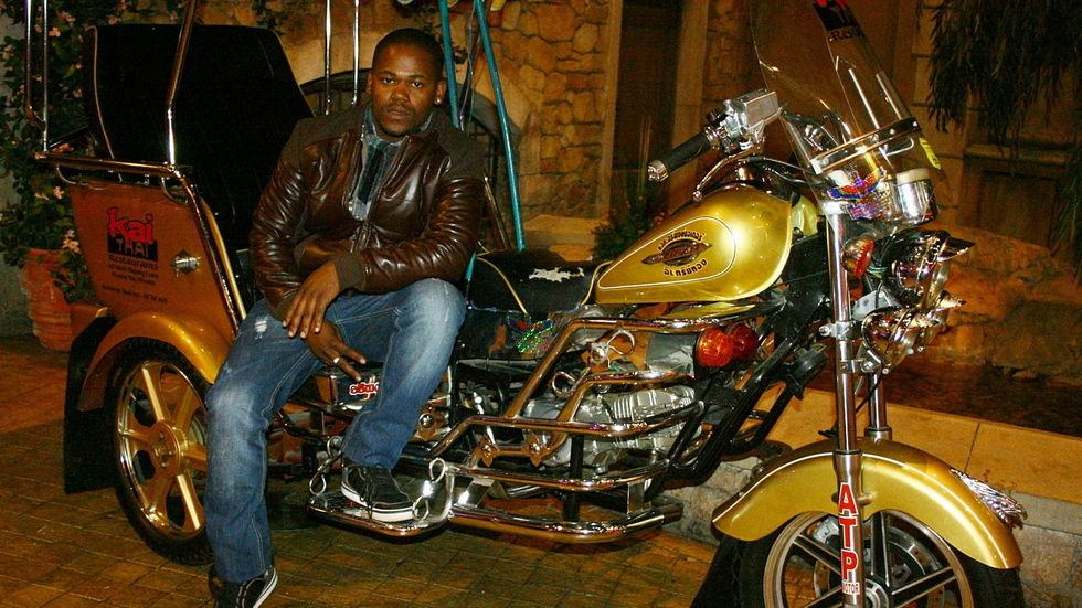 PRO sitting on a motorbike.
