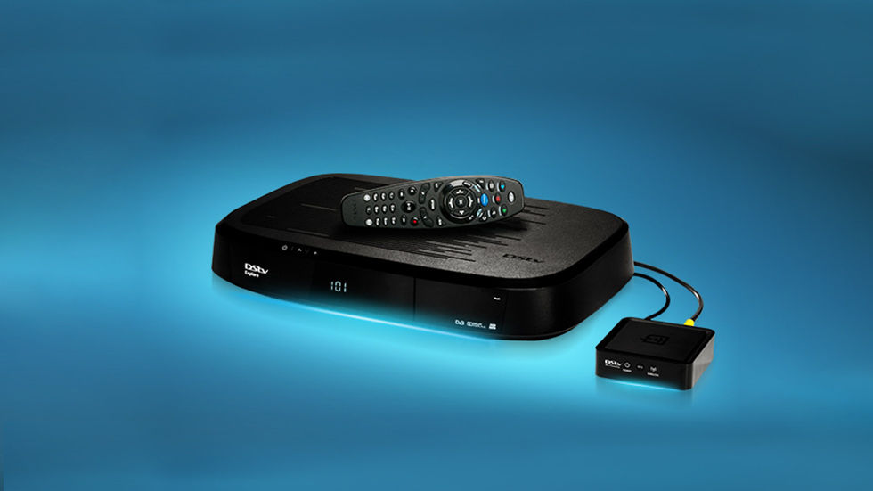 The DStv Explorer with remote, connected to the DStv WiFi Connector for Connected Services