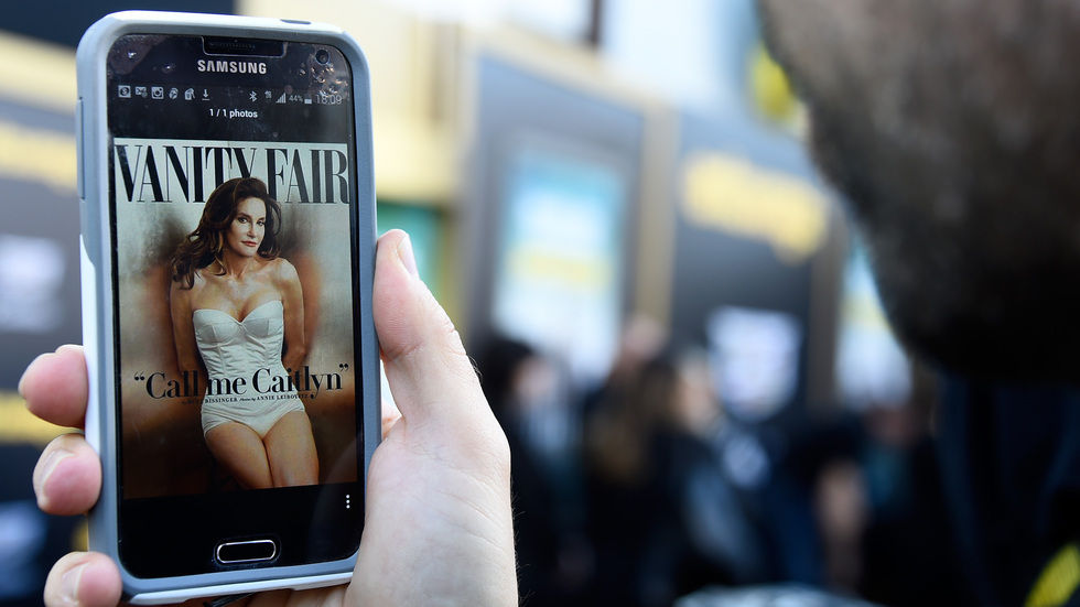 Caitlyn Jenner, formerly known as Bruce Jenner, seen on Vanity Fair cover on a phone.