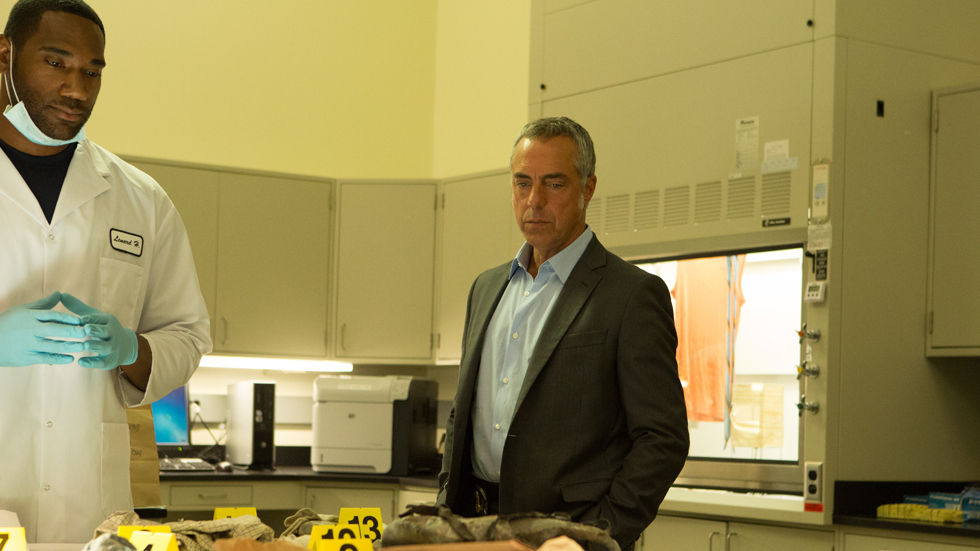 An image of Titus Welliver, who plays Harry Bosch, standing with a surgeon in a hospital room on Bosch.