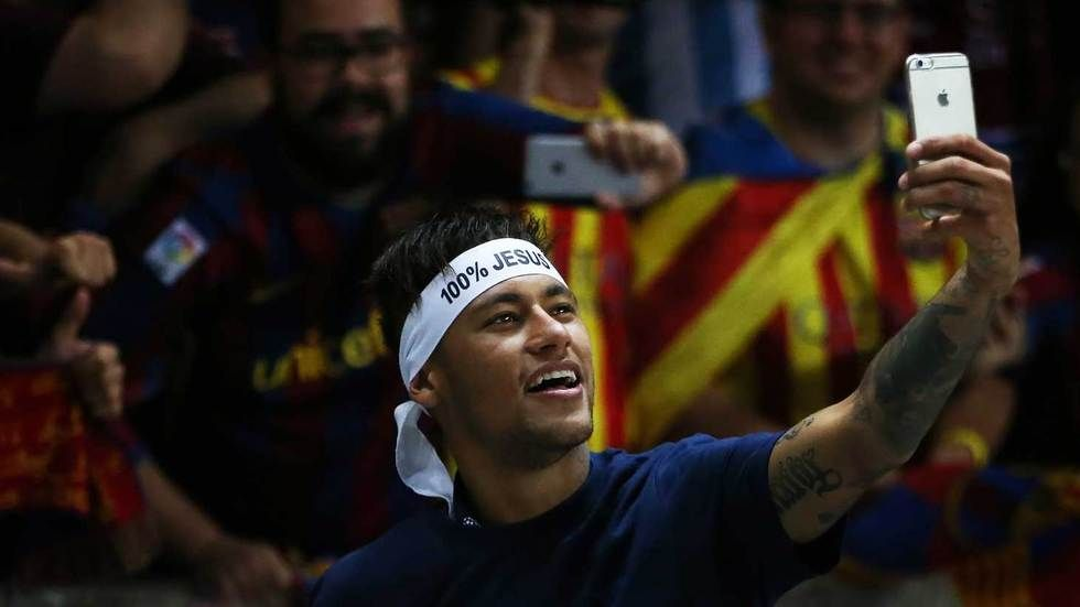 Neymar take a selfie with the fans after the Uefa Champions League final.