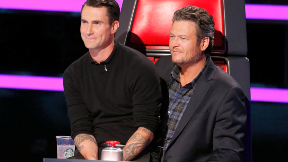 Adam Levine sitting on Blake Shelton's lap