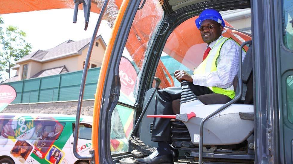 DStv CEO, in crane, with Kenya groundbreaking