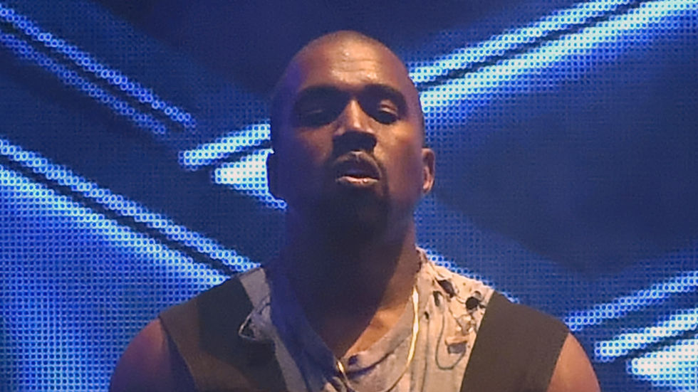 Kanye West performing on stage from Getty images.