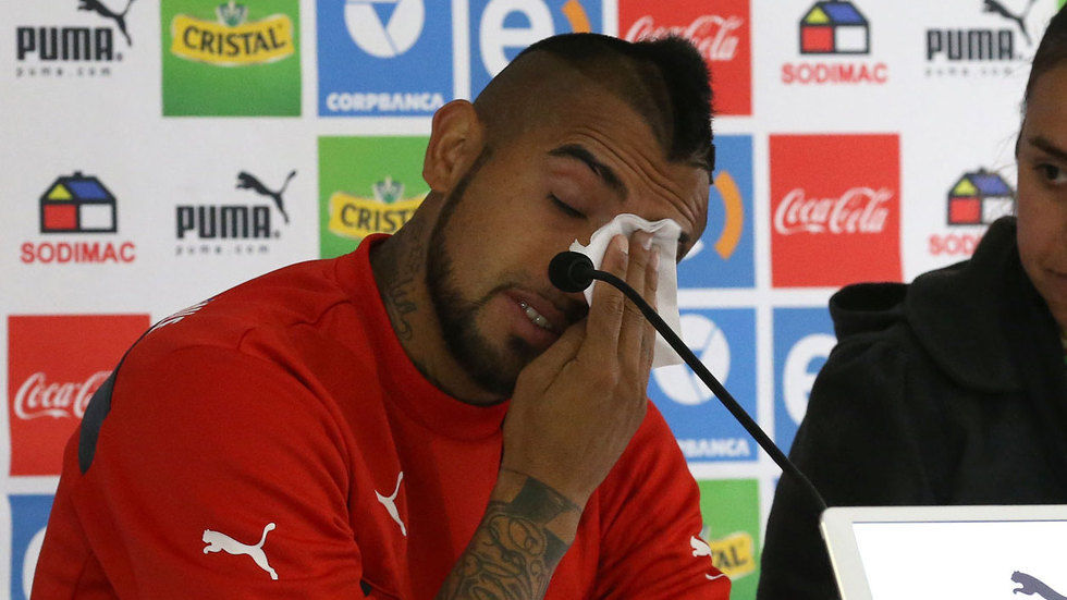Arturo Vidal wipes his tears in a press conference.