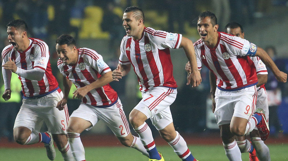 Players of Paraguay celebrate after winning against Brazil
