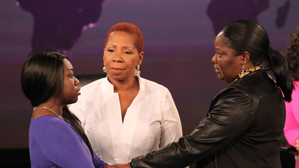 An image of Iyanla Vanzant and two ladies holding hands during Oprah's Lifeclass.