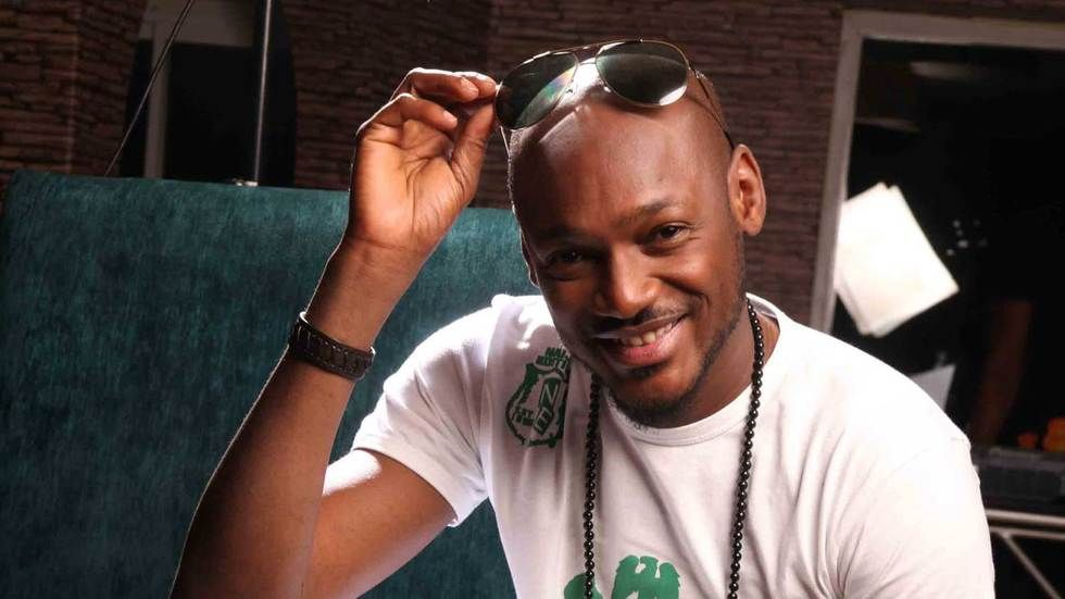 Musician 2Face poses for the camera.