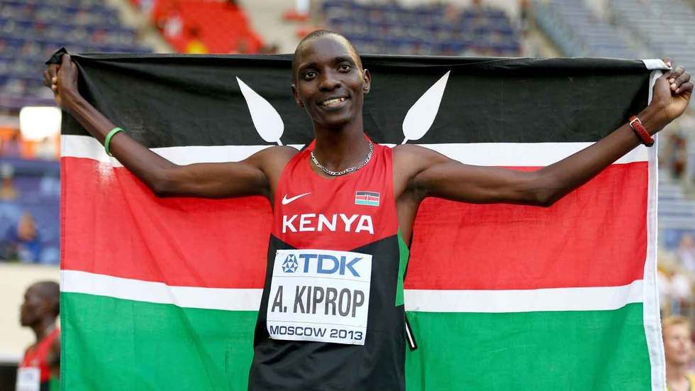 Asbel Kiprop proudly flies the Kenyan flag