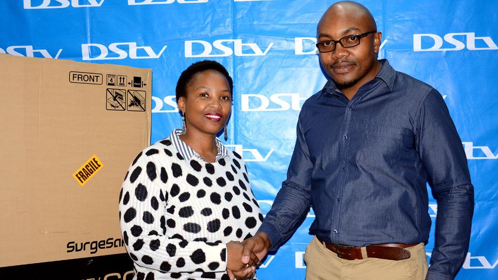 Multichoice Zambia DStv Marketing Manager Ndela Sichizya (right) congratulates Zonke Zisiwe