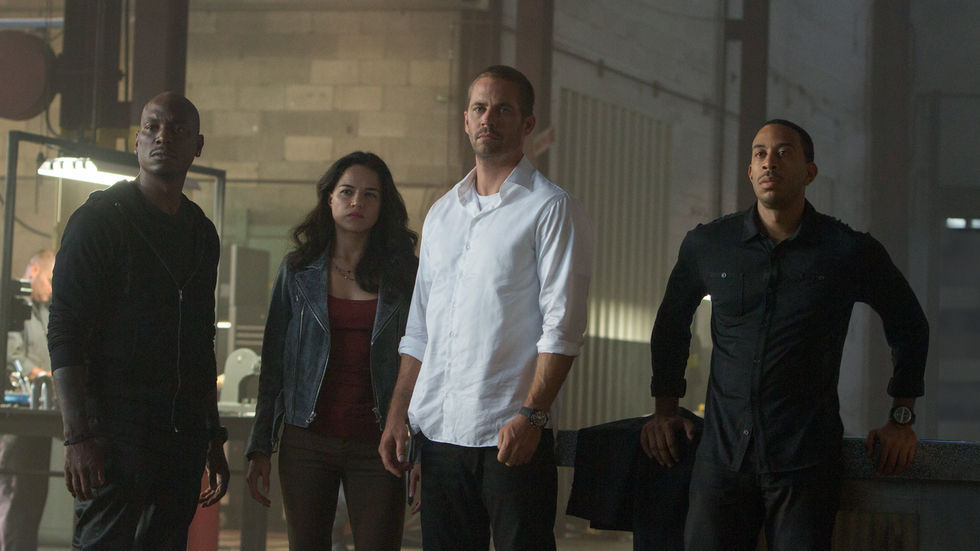 Tyrese Gibson, Michelle Rodriguez, Paul Walker and Ludacris in a still shot from the movie Fast & Furious 7.