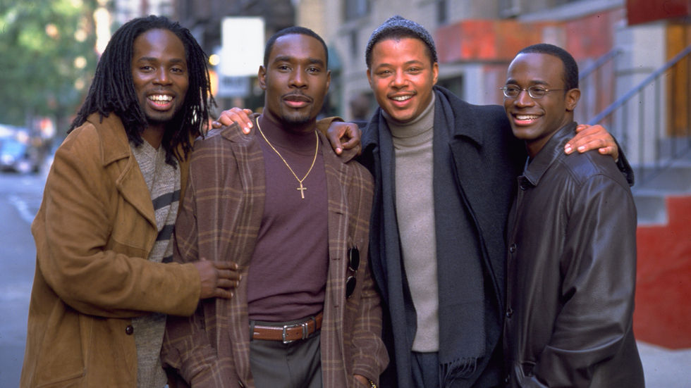 Terence Howard, Taye Diggs, Morris Chestnut and Harold Perrineau on a sidewalk