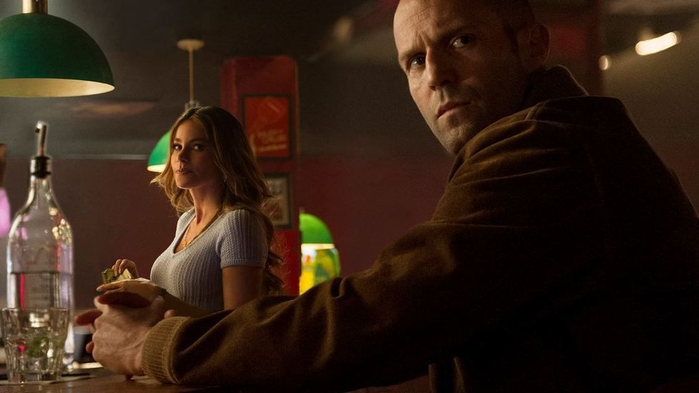 A still image of Sofia Vergara and Jason Statham in the movie Wild Card.