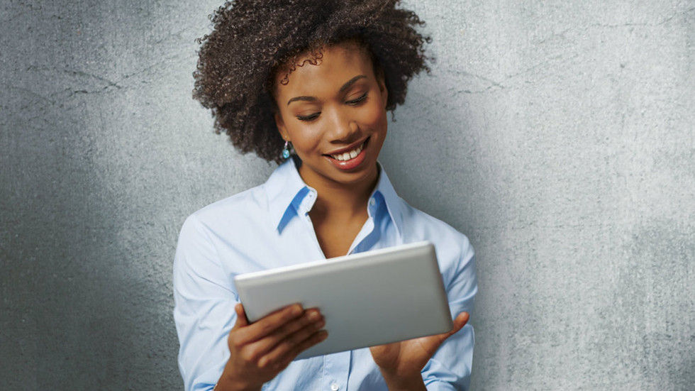 An image of a woman holding a tablet.