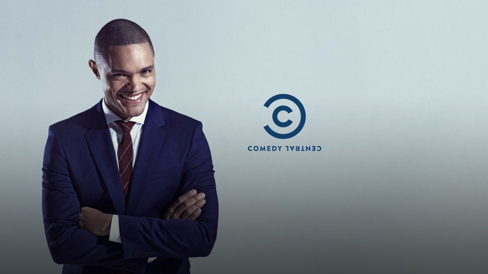 Trevor Noah with Daily show and Comedy Central logos