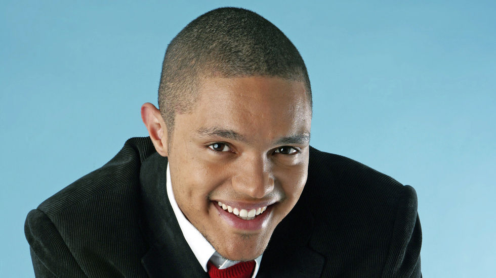 Close up of Trevor Noah in a suit.
