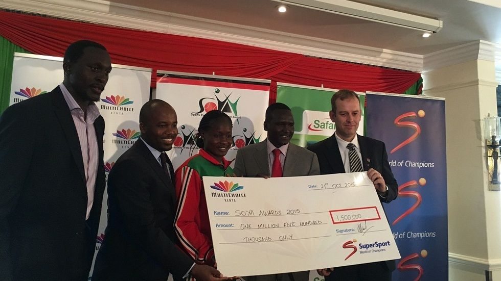 Andre Venter SuperSport Head of Africa presents 1.5million cheque to SOYA commitee