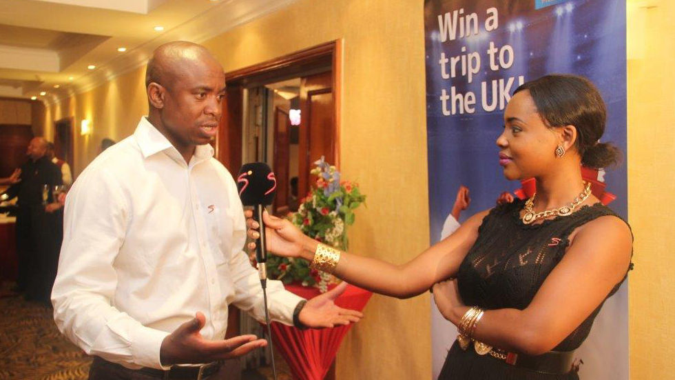 Cleo Mulenga presenter of the Bola YAPA Zed magazine show talking to SuperSport commentator Franklin Tembo Jr during the launch of the TV Magazine show at Southern Sun Ridgeway Hotel in Lusaka
