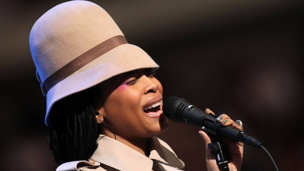 Erykah Badu performing on stage.