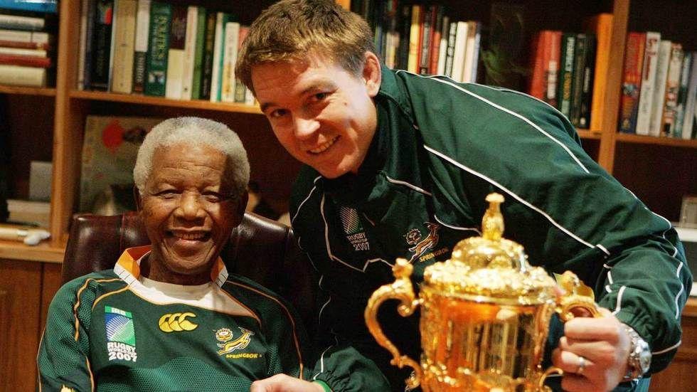 Former Springboks captain John Smit poses with Nelson Mandela.