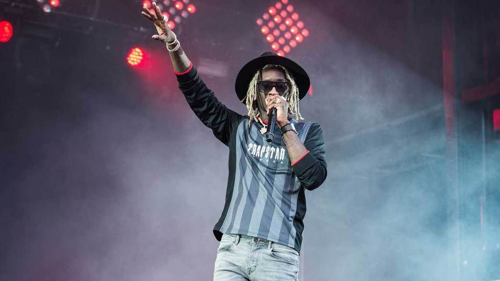 Young Thug performs on stage.
