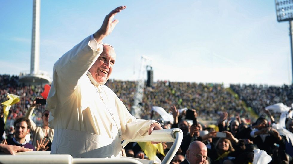 Pope Francis waving at the public