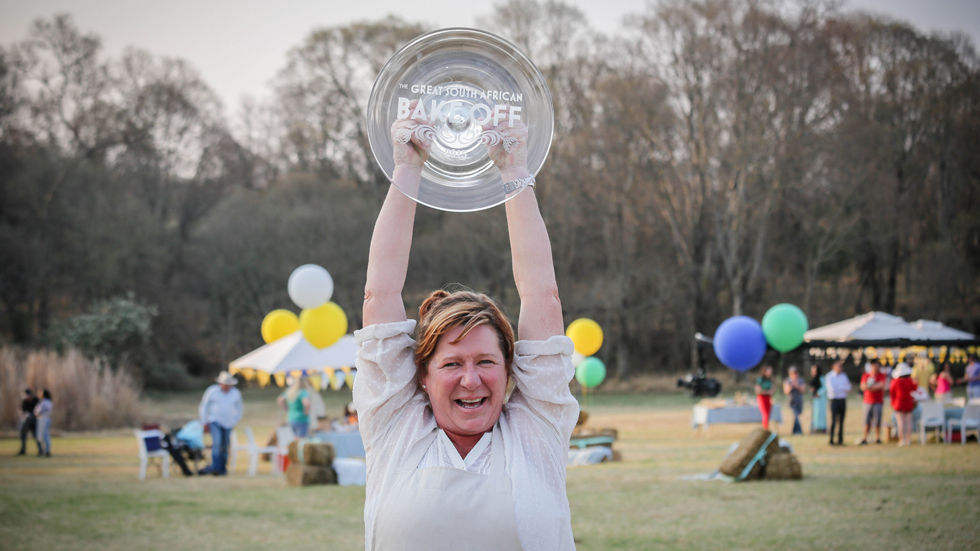 An image of Dot Dicks holding her prize.